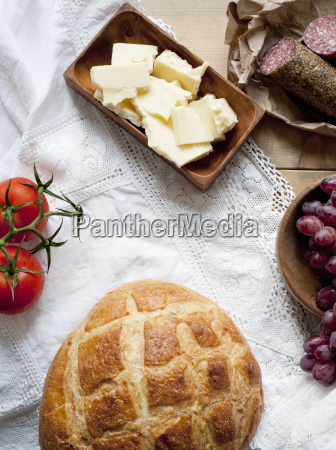 bread cheese salami grapes and tomatoes