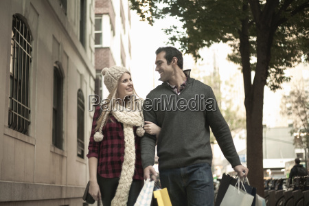 young tourist couple arm in arm