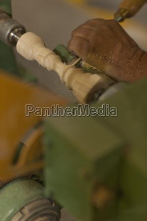 close up of carpenter turning wood