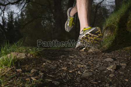 man wearing trainers running close up