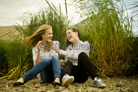 two young women laughing in breeze