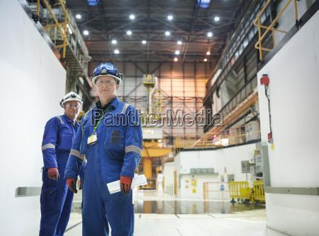 portrait of engineers in reactor hall