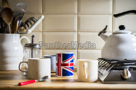 kitchen counter with jug of utensils