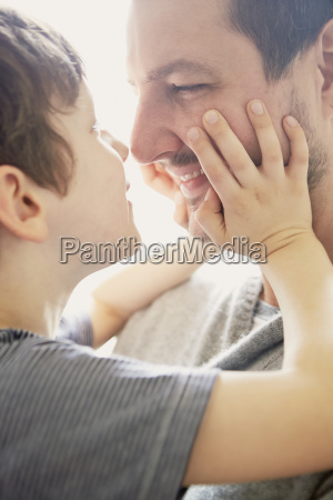 boy showing affection to father
