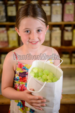 girl holding bag of confectionery
