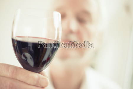 man holding red wine close up