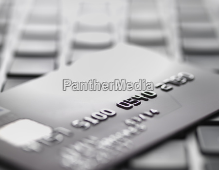credit card on laptop to illustrate