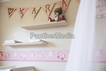 decorated pink nursery with name on
