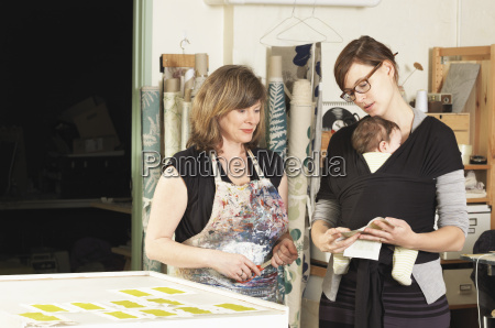 women discussing design in hand printing