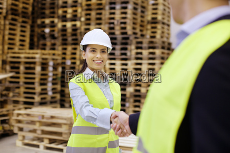 supervisor and trainee shaking hands in