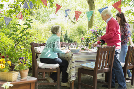 family sitting down for an outdoor