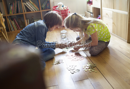 brother and sister counting coins from