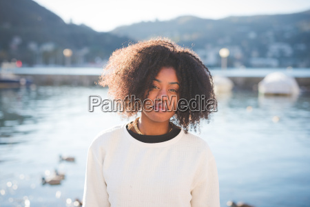 portrait of young woman at lake