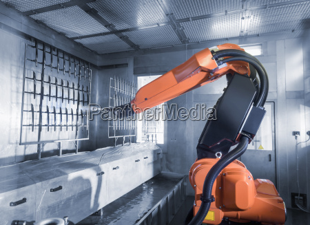 robot spray painting automotive parts in