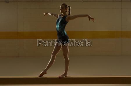 teenage gymnast on beam