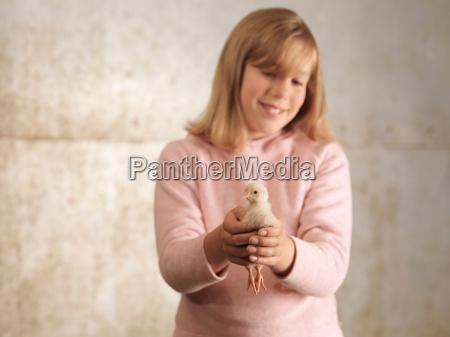 girl holding chick