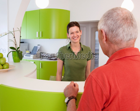 receptionist with patient in surgery