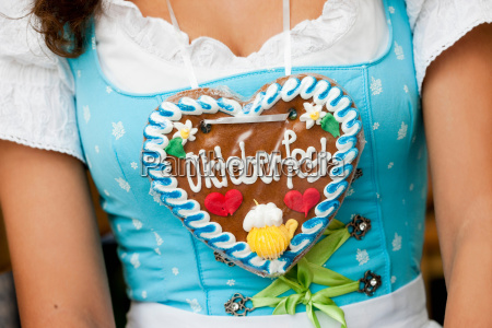 young woman gingerbread heart close up