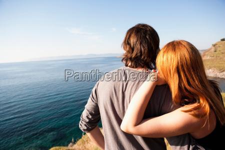 young couple looking at horizon
