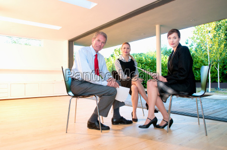 three business people in light office