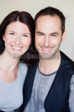 couple smiling at viewer