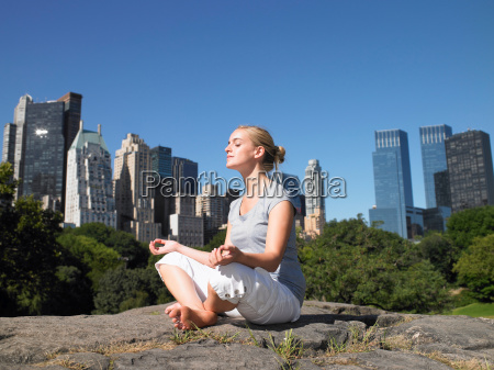 woman doing yoga in central park