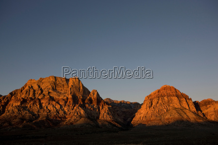 mountains in sunrise with blue sky