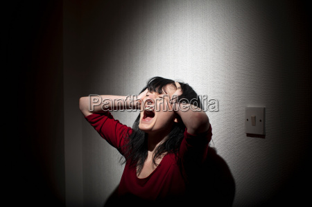 woman shouting indoors