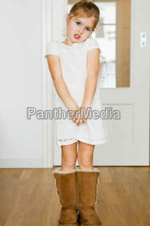 girl wearing fuzzy boots indoors