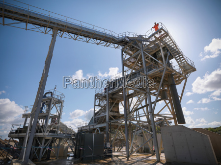 workman standing on stone screening and