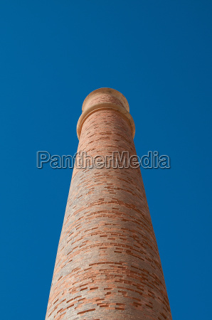 low angle view of smokestack
