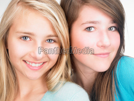 girls smiling at the camera portrait