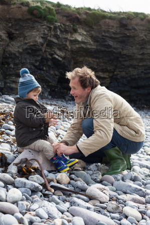 father and son playing on rocky