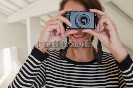 personal perspective of woman taking photograph