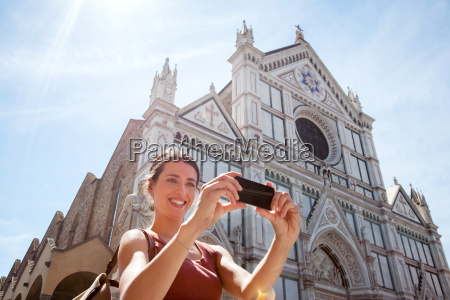 woman outside santa croce church piazza
