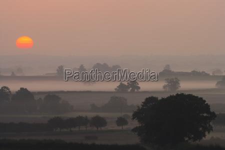 sunset over rural scene shropshire england