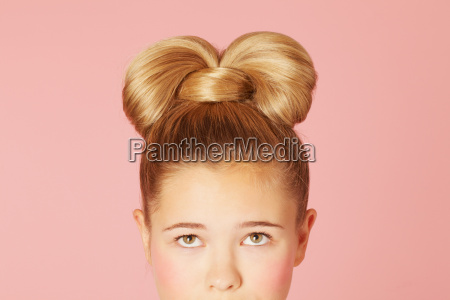 teenage girl with ornate hairdo