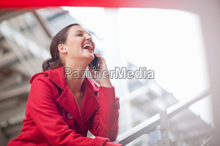 young woman on cellphone in shopping