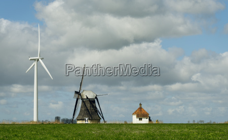 landscape with wind turbine and windmill