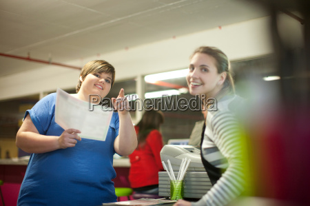 young woman ordering from menu in