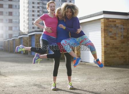 portrait of three women wearing sports