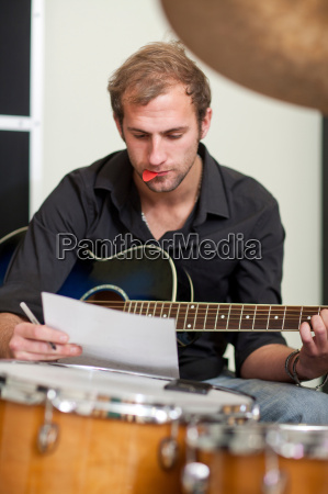 young musician making notes