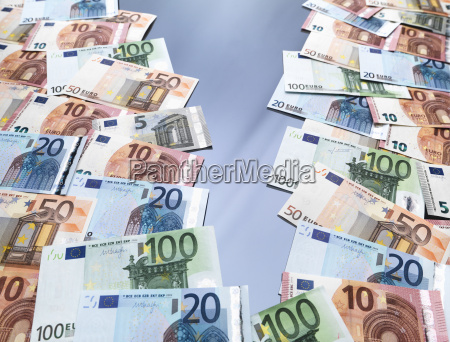 euro currency notes split into two