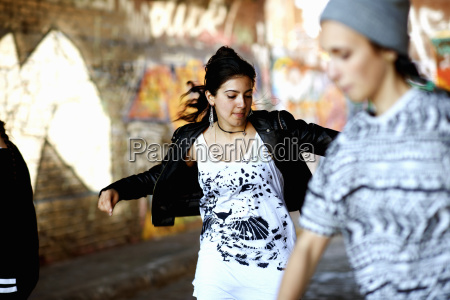 young women dancing in the street
