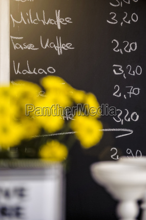 yellow flowers in front of cafes