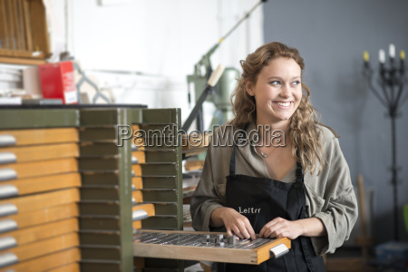 woman with letterpress tray in print