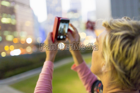 woman taking photograph in hong kong