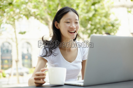 young female tourist using laptop at