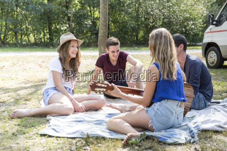 group of young adults sitting on