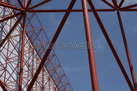 tall red framework structure with textile